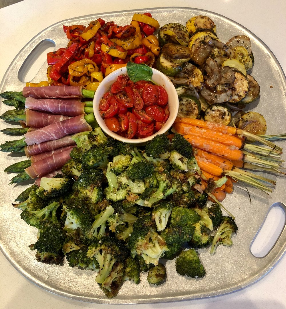We were expecting a group of 20+ guests, so we gave these veggies a quick roast ahead of time to speed up the cooking process at dinnertime - but it also works as a whole evening of entertainment if you choose to skip that step. We LOVE our versatile  Wilton Serving Tray !