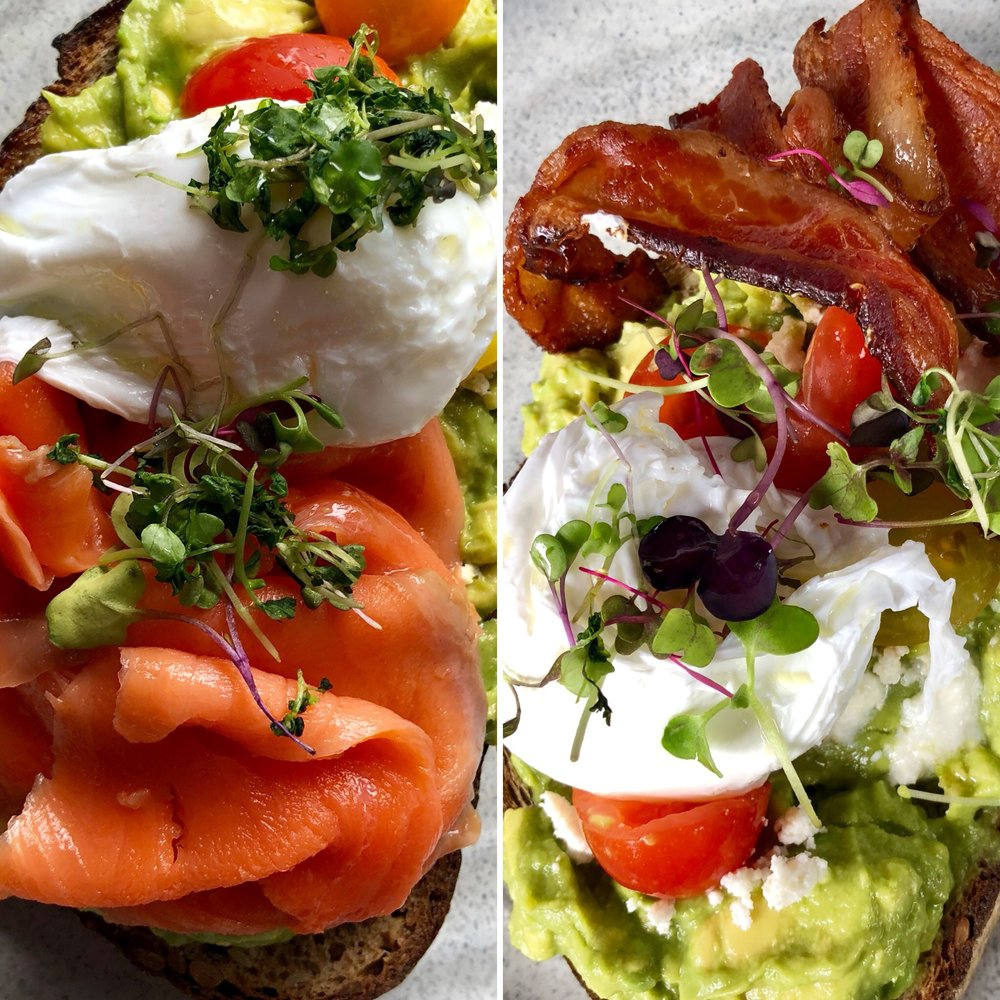 Classic Avocado Smash on Balthazar toast with heirloom cherry tomatoes, feta, and sunflower sprouts. On the left, we added Grizzly smoked salmon and a poached egg. On the right, we added bacon and a poached egg. Both delish!!
