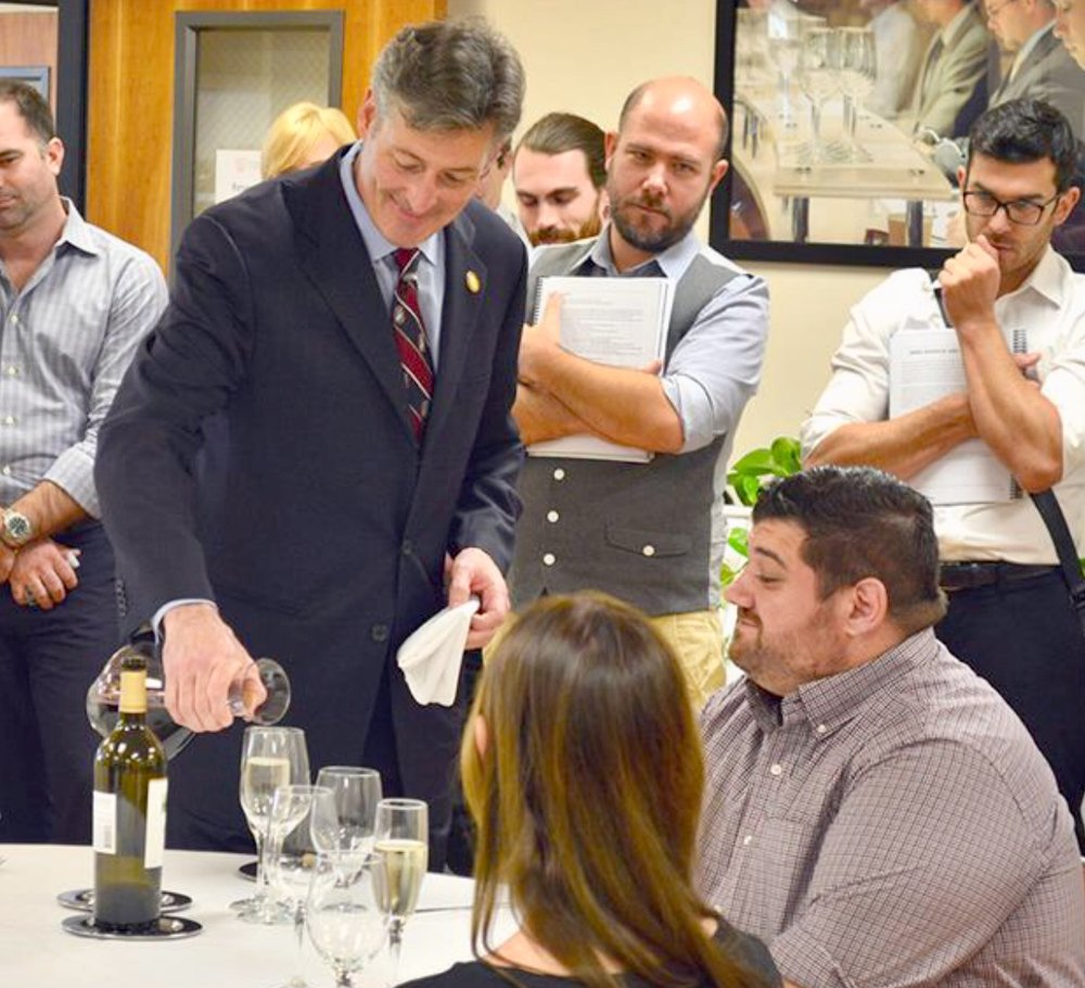 A Master Sommelier providing a service demonstration for the class. (Photo courtesy of Court of Master Sommeliers)