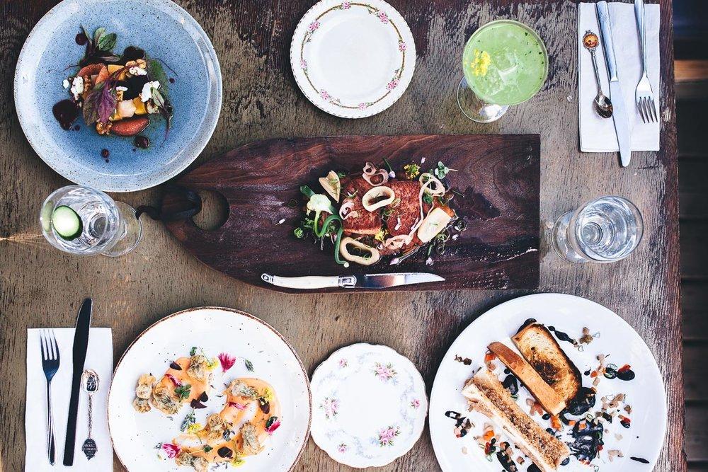 Saskatoon-0065-The-Hollows-Table-Full-of-Food.jpg