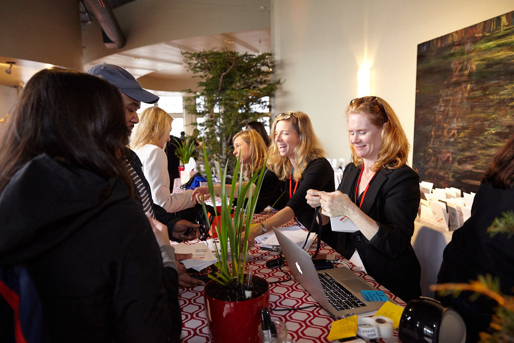 Kennedy Events Event Producer Robin Smiley and Partner Maggie Kennedy assist attendees at the registration desk for an event in San Francisco. Sometimes just having someone to talk to makes all the difference.