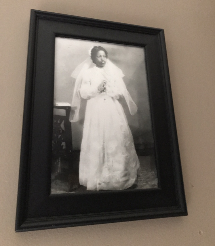 My Mom, Marie Jose Labossiere, circa 1955 in her first communion dress in Haiti.