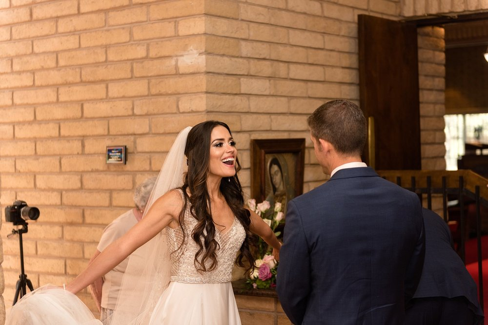 This is one of my favorite shots from the day. As a candid wedding photographer, I love to capture those raw joy-filled moments that happen when no one is looking!