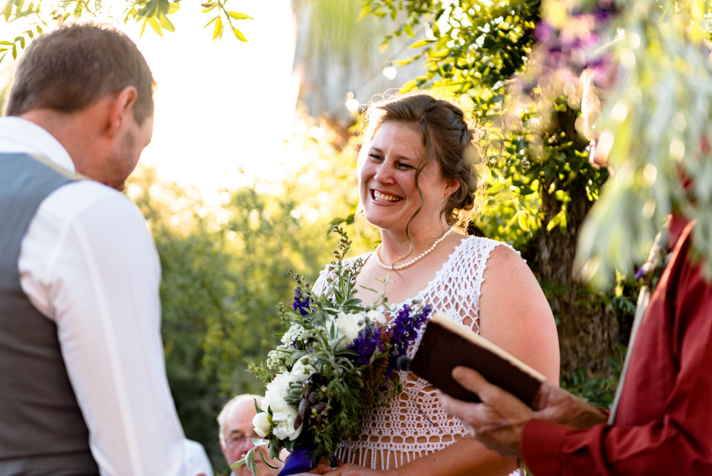 The bride's genuine smile made her glow. She looked beautiful in her crochet dress and her bouquet looked so organic.