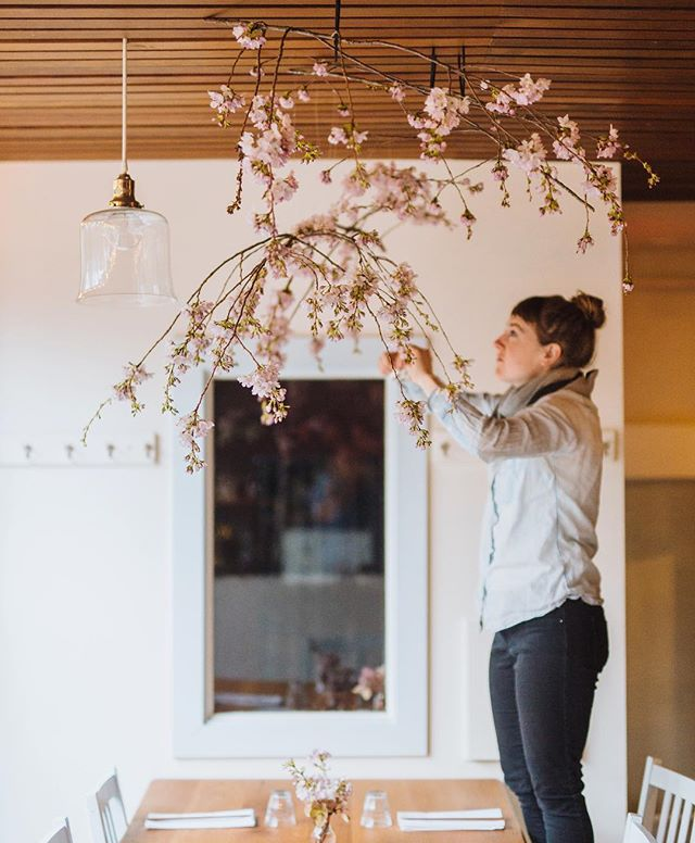 Wishing @botanicallyinspired would come decorate my house with cherry blossom branches, like she did the @tournantpdx dining room for our Blossoming Spring brunch this time last year 🌸✨ photo by @pdxploration