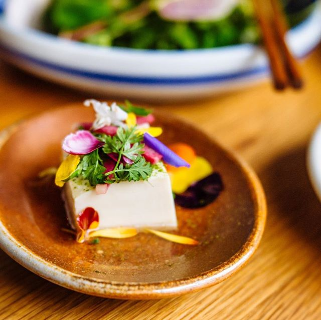 One week from today @tournantpdx !!! Oyster social with all the friends. New dishes and a few familiars from printemps past, like this sexy lil number- Ota tofu with sakura shoyu, green garlic powder, baby vegetables and herbs and fleurs. (Sneak peek of the full menu this weekend.) 4/5, 5-9 pm, bring friends or come solo, walk in/communal seating/convivial vibes! Plant-based folks and pescatarians will be eating especially well :) 📸 @pdxploration