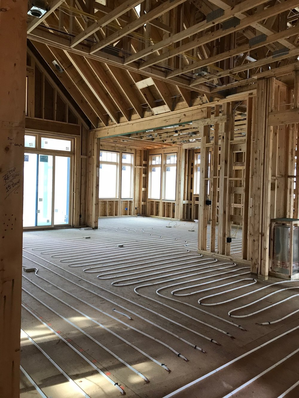 Radiant floor system being installed in an OC custom home located in Falcon Ridge
