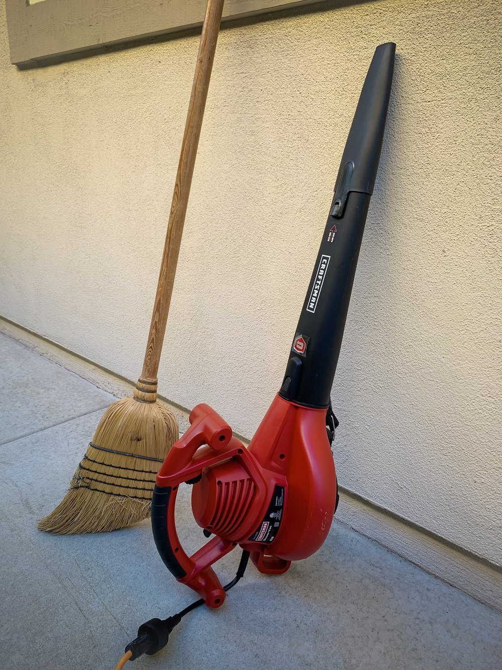 Upgrade - Out with my old broom, in with my new leaf blower. Click to shop
