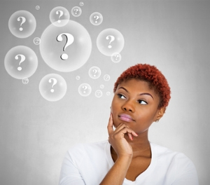 Black woman thinking with question marks.jpg
