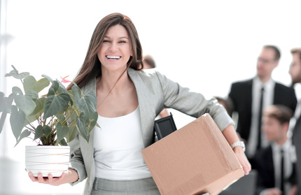 woman packed up office and leaving.jpg