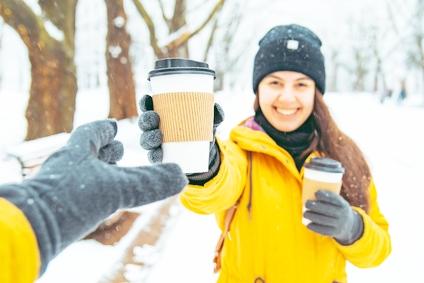woman handing coffee to friend in snow edited.jpg