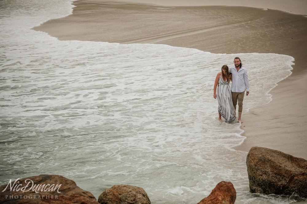 Pre-wedding photo session at Little Beach, playing in the waves