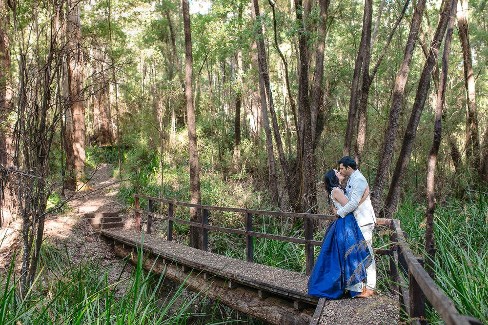 Bride and groom on a bridge in the forest, Denmark Western Australia