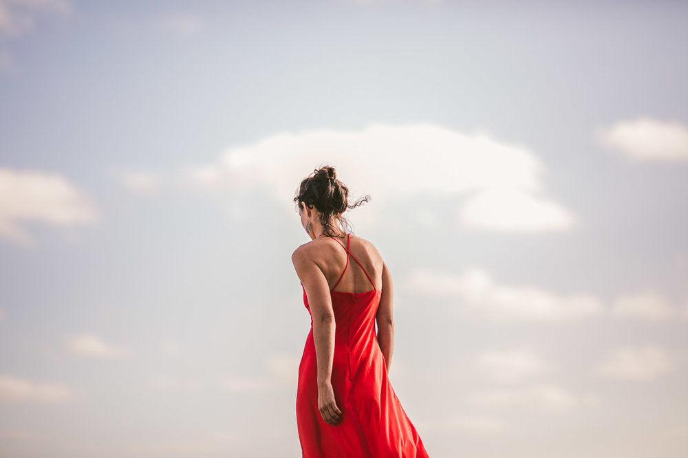 Fire meets sky, red dress and blue sky with clouds