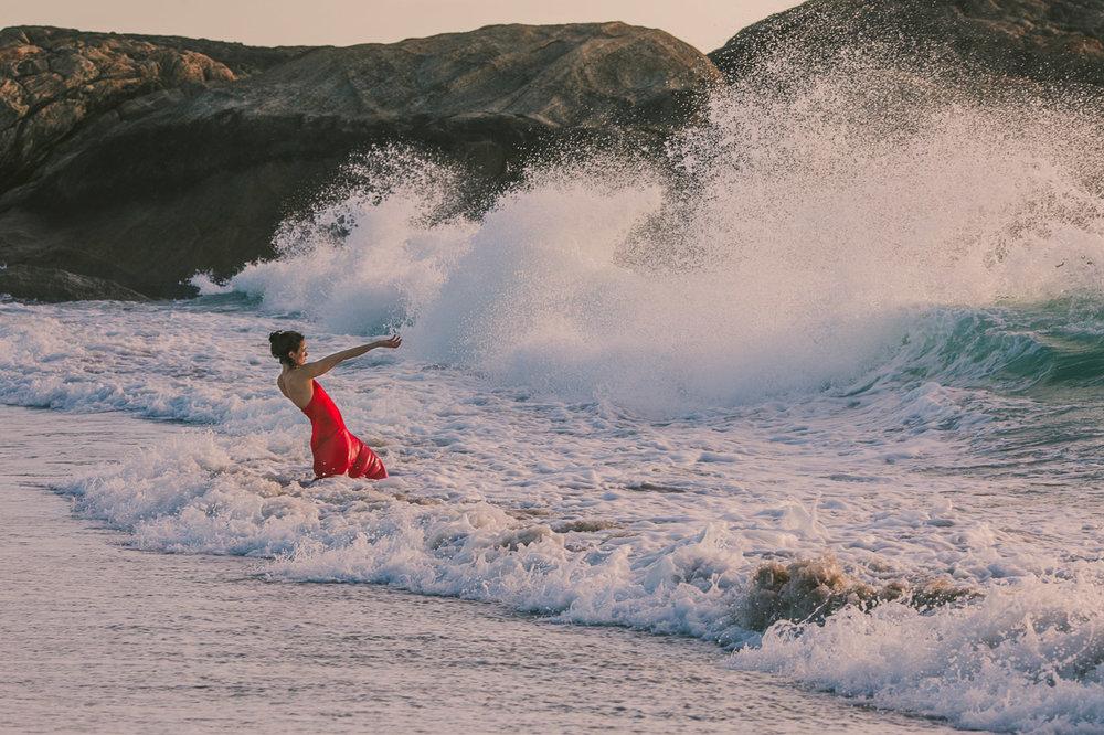Forces of nature, artist Kate Gillett holding back the ocean.
