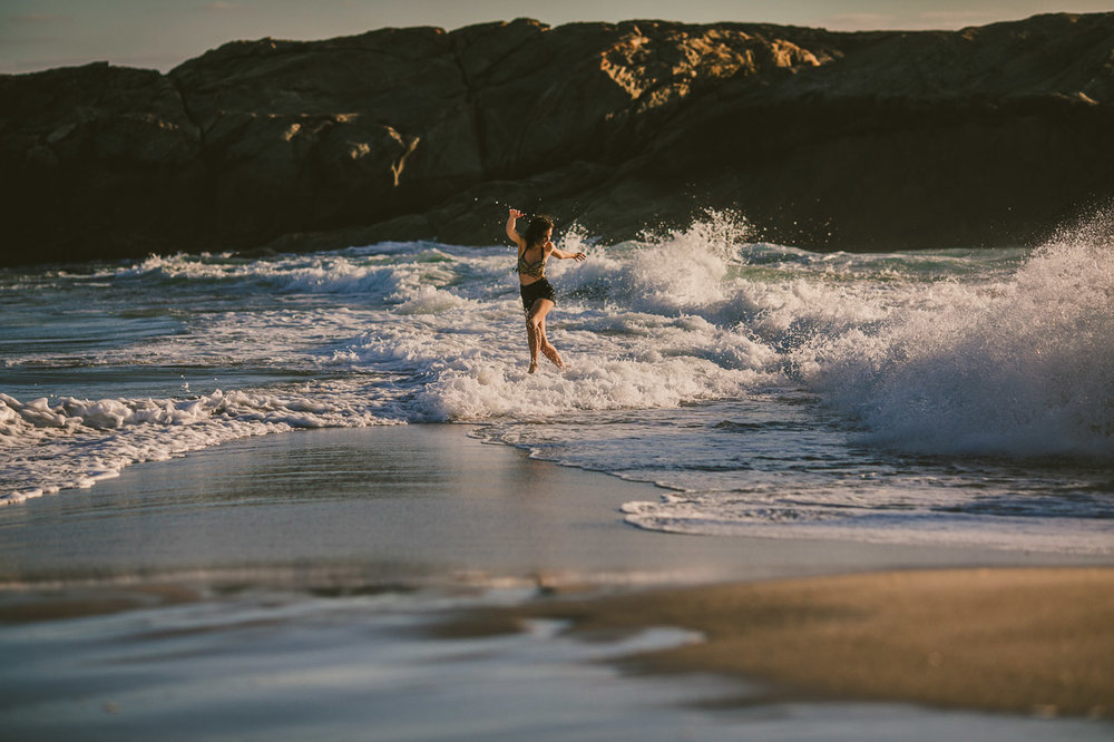 Woman dancing in the waves