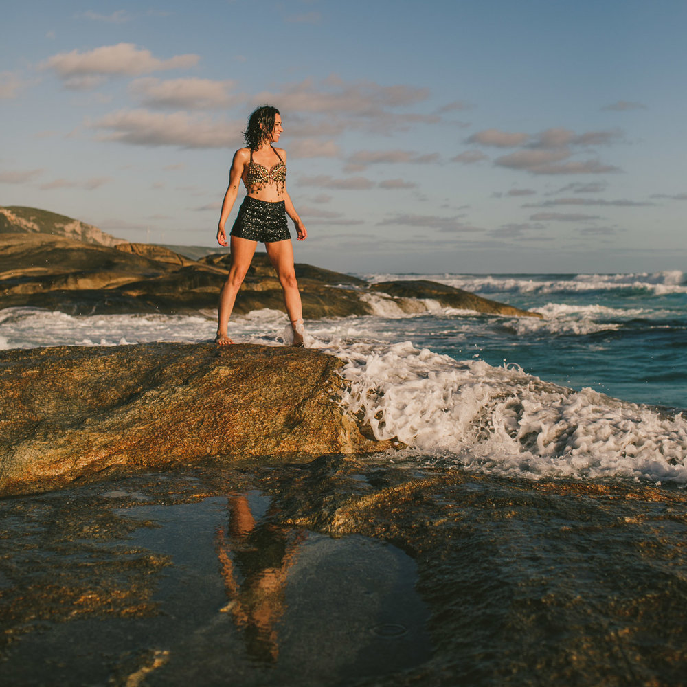 Portrait of a woman on the rocks by the ocean