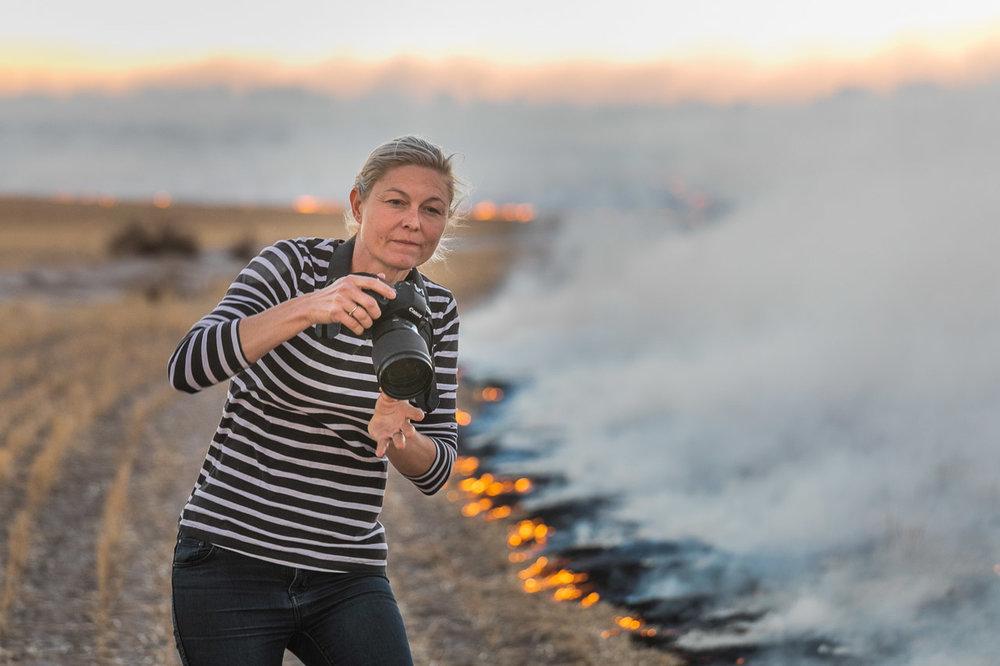 Bruce Rock photographer and farmer, De Strange during windrow burning
