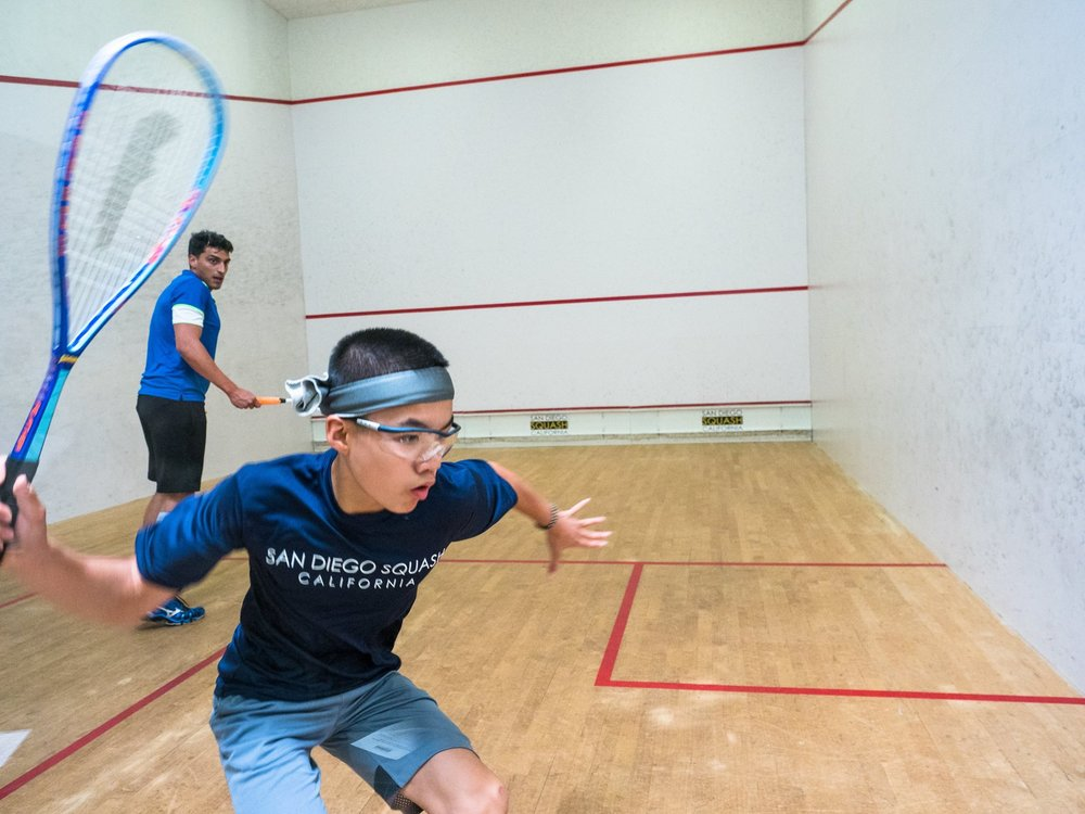 Eric Lin on-court using the Titanium Drop 110 Feather Squash Racket.