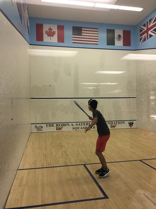 Eric Lin warming up before his match against Vishal Prashant