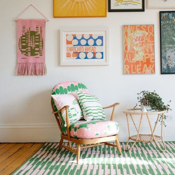 If your friends are noticing the gaps between pictures instead of the beautiful art on your wall, you should passive aggressively get them a how to guide on being more cultured for their birthday.  Gorgeous space is  Laura Spring's Studio.