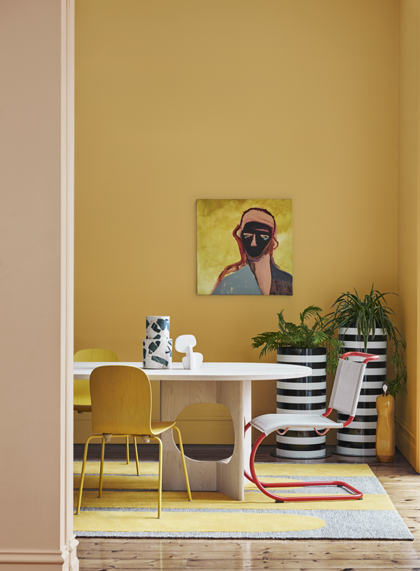 Dulux Identity palette. Photo by Lisa Cohen, Styled by Bree Leech. Wall colour Dulux Tata Beach (rear) and Dulux Roxburgh (front). Artworks:  ' Mustard' original painting by Stacey Rees,  Modern Times (on wall), ' Sculpture 13 'original sculpture by Mark Alsweiler,  Modern Times (far right on ground).