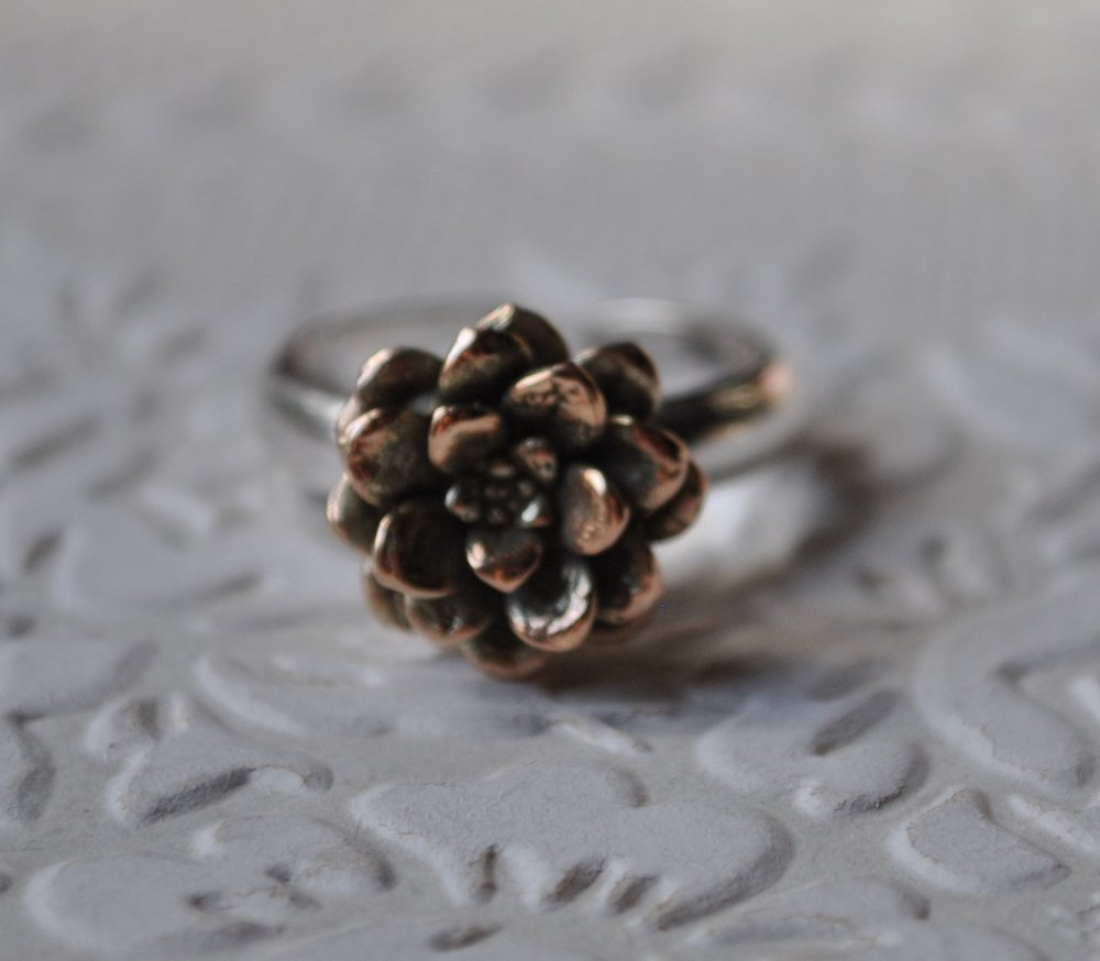 9ct pink gold and sterling silver flower ring    $390