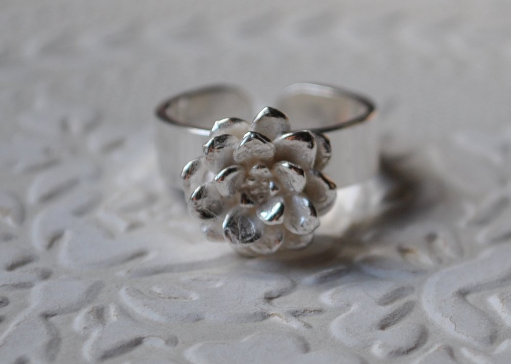 Sterling silver flower ring    $160