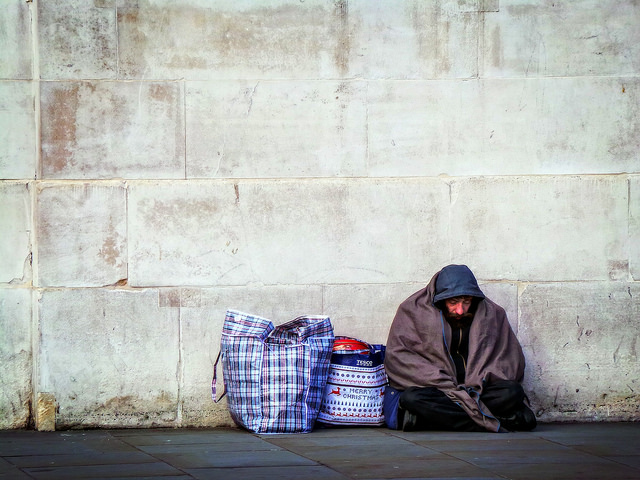 Homeless by a wall, Garry Knight, 2014