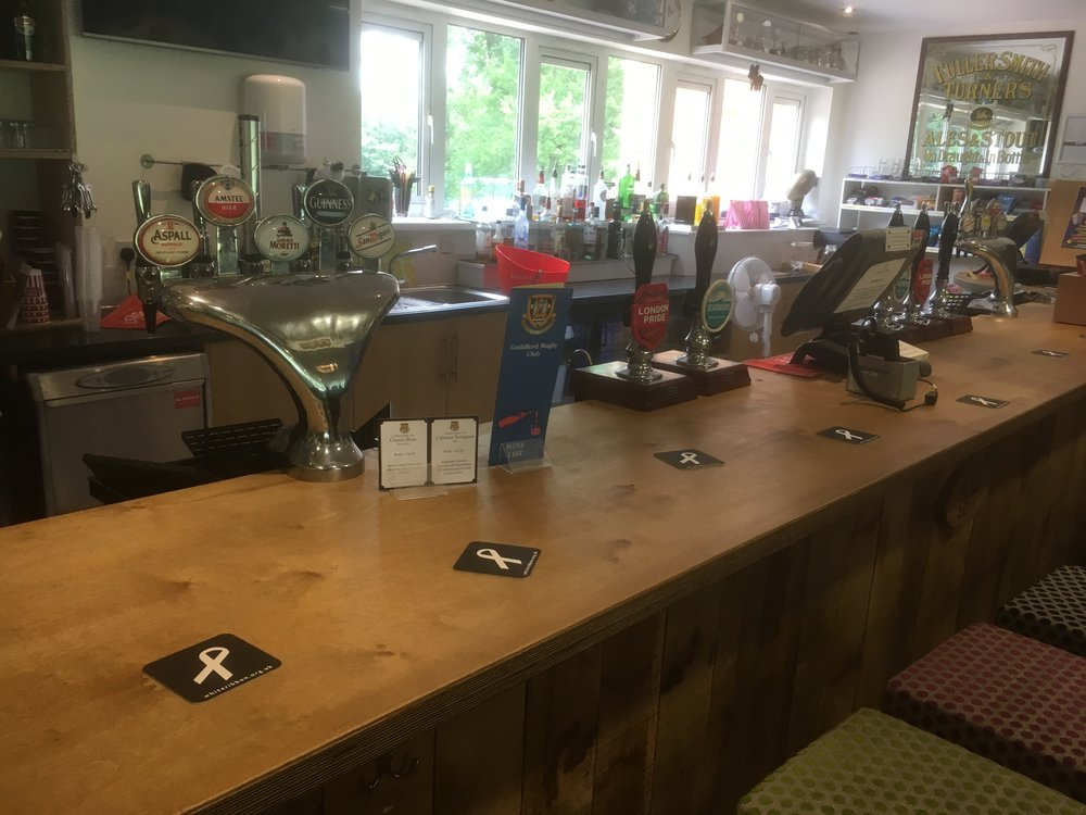 White Ribbon Beer mats on the bar at Guildford Rugby Club