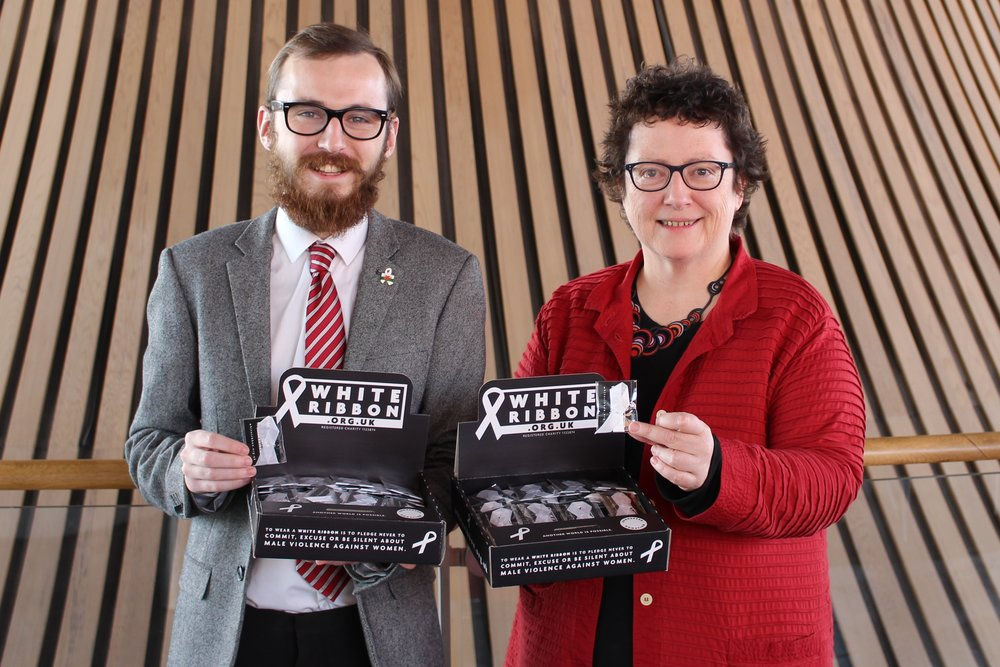 Jack Sargeant AM with Welsh Assembly Llywydd, Elin Jones AM selling white ribbons at Welsh Senedd in Cardiff.