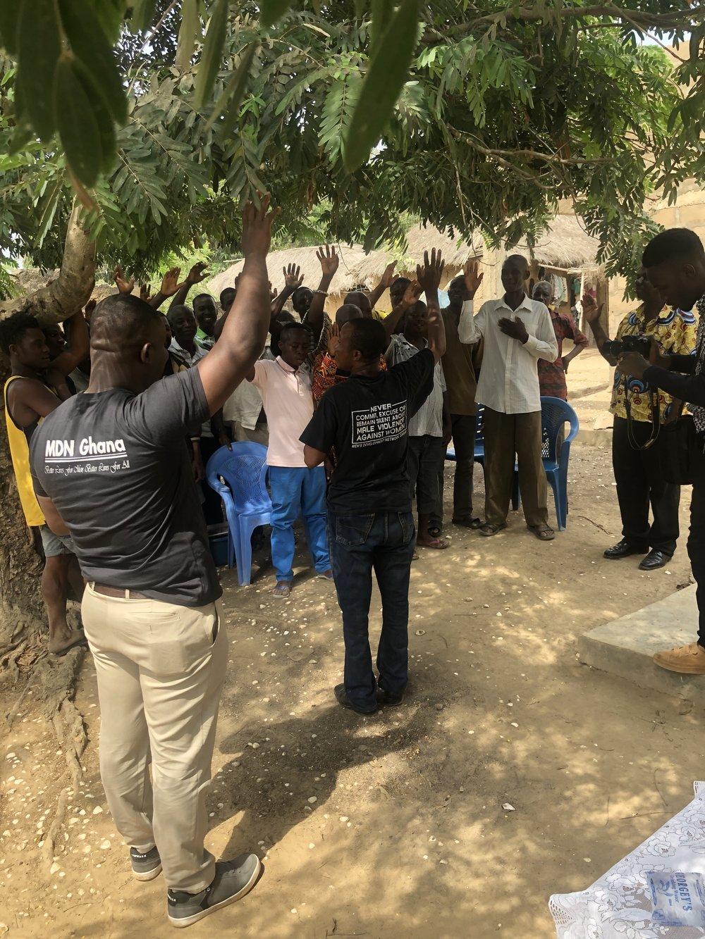 Villagers in Ghana taking the White Ribbon pledge.