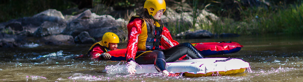 Yes – it's as fun as it looks, probably more. Yes – you need a helmet (bike helmets are okay). Yes – surf lilos are the best if you are serious about winning. But other flotation devices (tyre tubes in particular) are good. Wetsuits? Your call – you have to run 1.5km to your tube... so maybe not. And it'll be summer, the river will be cold though.