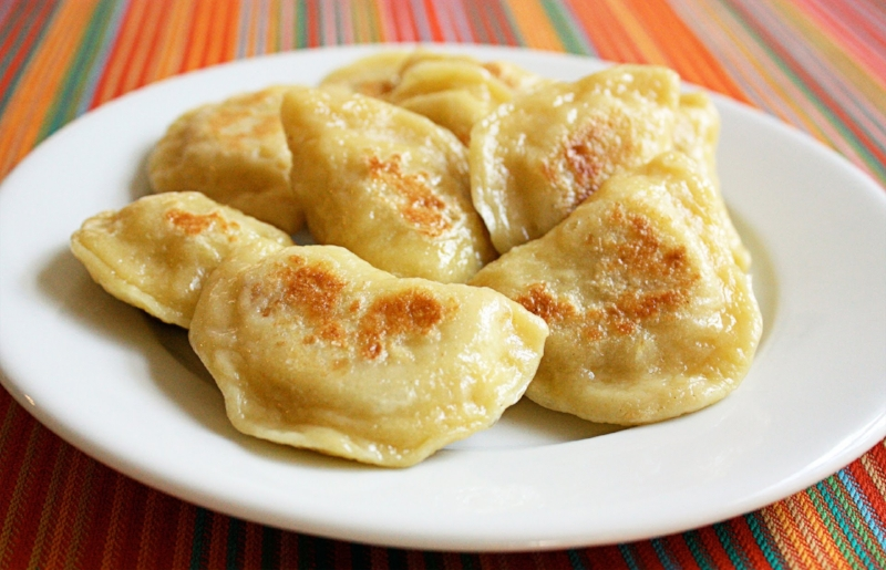 A plate of fried pierogis