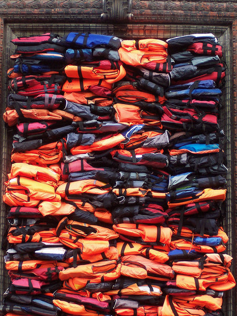 Ai Weiwei,  Soleil Levant,  installation of refugees' life jackets on the facade of Kunsthal Charlottenborg, Copenhagen (2017).  (c)  TeaMeister