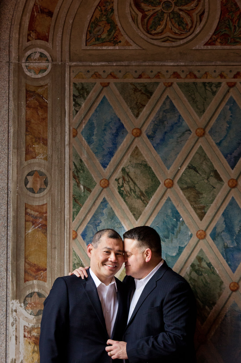 Just married snuggles under the Bethesda Terrace. Photo by  Konrad Brattke Photography.