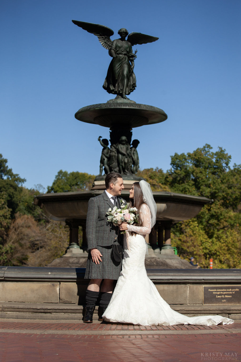 Kilts and kisses under an angel. Photo by  Kristy May.