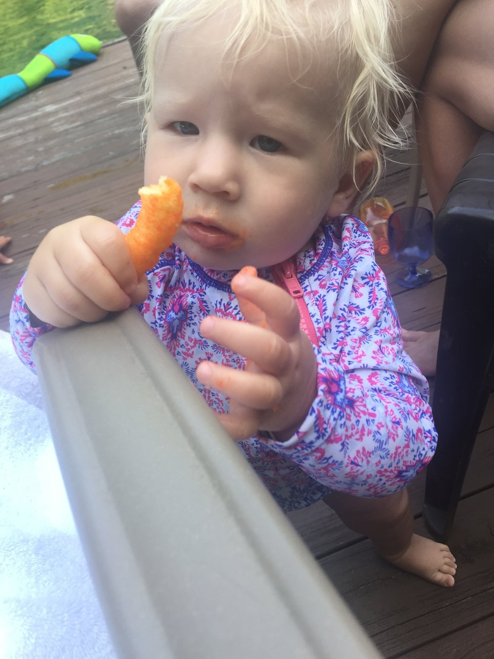 "Such a guilty confession. I have an obsession with Cheetos but I'm only ""allowed"" to eat them twice a year and the Lake House is one of those times. This year, we introduced my adorable 1 year old niece to Cheetos and now she understands my obsession. I mean, did you watch that video of her feeding my (future) sister-in-law by the handful?"