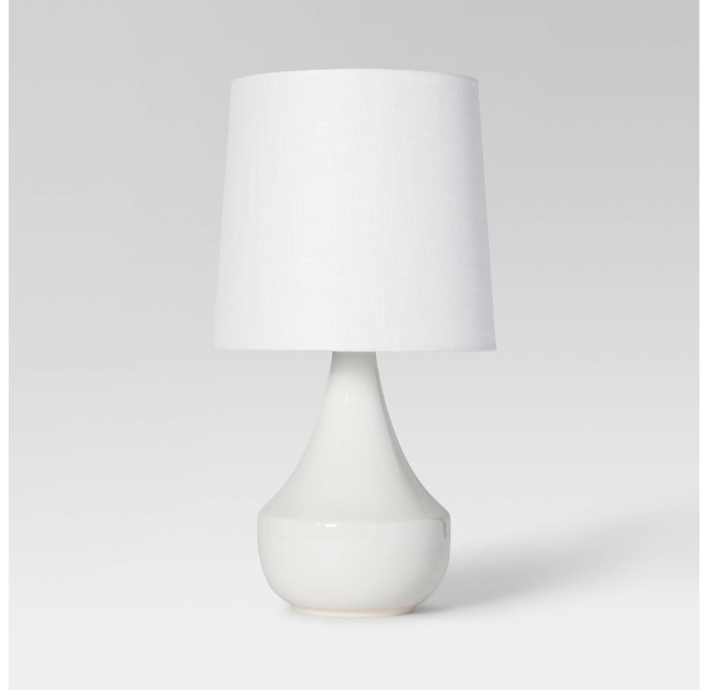 Classic White Table Lamp - If you're looking for a simple white table lamp, this is it. The design is lovely, and of course you can't beat a clean white look. I need like 5 of these around my home in various places. You can find it HERE.