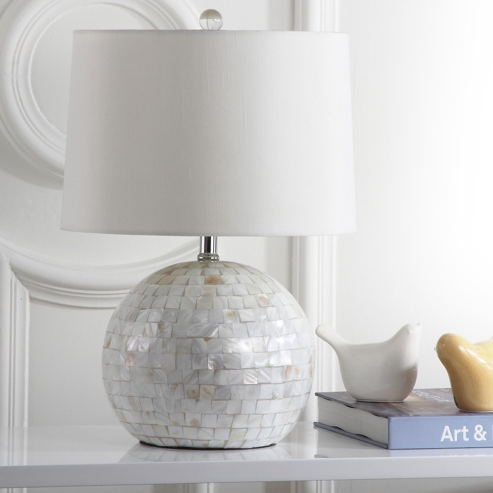 Shell Creme Table Lamp - This lamp has a really soft look to it, which I also really like. The shell look has that pearly color that would probably look great anywhere! Find it HERE.