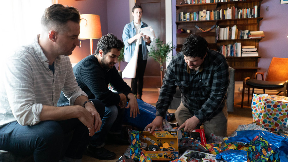 (Left to right): Director Kess, Producer Kyle, and Production Designer Ian, discuss the placement of props on set.