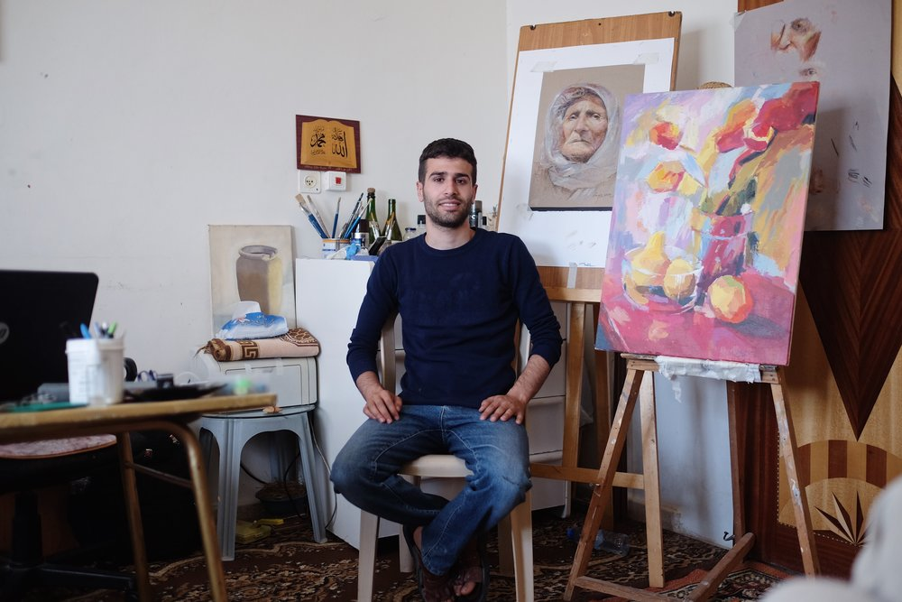 """Ahmad Yaseen, 22, in Asira al Shamaliya says 50 years since the 1967 war doesn't mean anything special to him. """"I think of everyday as a day to remember the occupation,"""" he says. """"The purpose of the anniversary is to say 'Okay - What am I going to do about it?'"""" What Yaseen decided to do is to make art. His latest is a portrait of Om Aseer Shahib, mother of a prisoner who died in prison two months ago.From a series of portraits commemorating the 1967 War."""