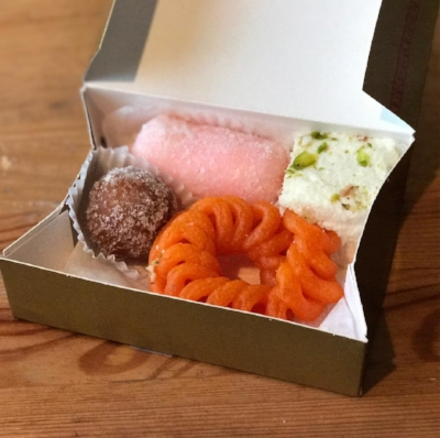 Sweets from Maharaja Sweets and Snacks in Jackson Heights, Queens. Kalakand, janghiri, coconut jamun, pink cham cham.