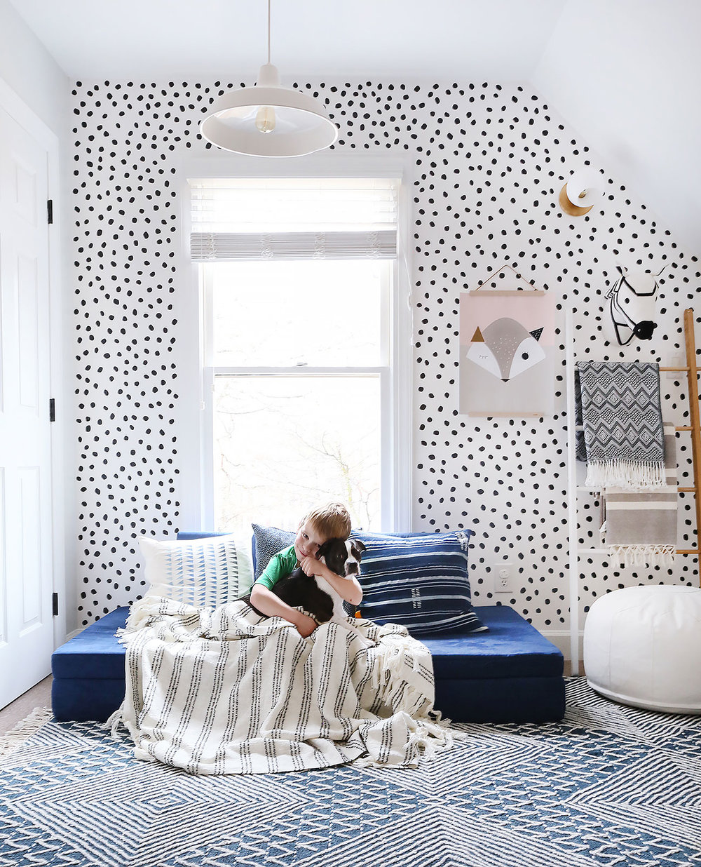 rug   /   geometric pillow   /   wall decals   /   white pendant light (similar)   /   blanket ladder   /   white pouf