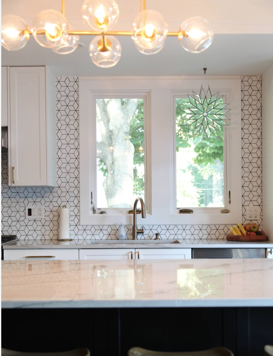 Moving away from - boring backsplashesToward - wallpaper-like backsplashes  - Again, homeowners are moving away from stark and toward interesting. A fun and easy way to do this is using a pattern in your backsplash. This doesn't mean you have to go crazy with color and pattern (although you certainly can!). Using white tile with an interesting shape can be just as impactful and less risky. I recently installed a white hexagonal tile with charcoal gray grout in a kitchen and it turned out beautifully. The kitchen featured to the left is a great example as well.