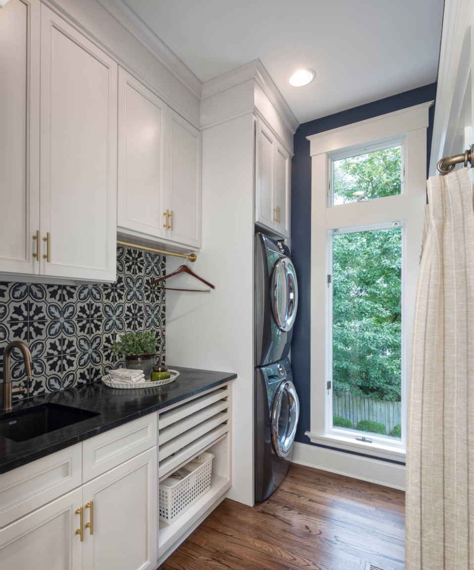 - And if you want more color and interest, this laundry room is perfection! That backsplash has just enough going on to draw you in, while the rest of the room is subtle enough to let it take center stage.