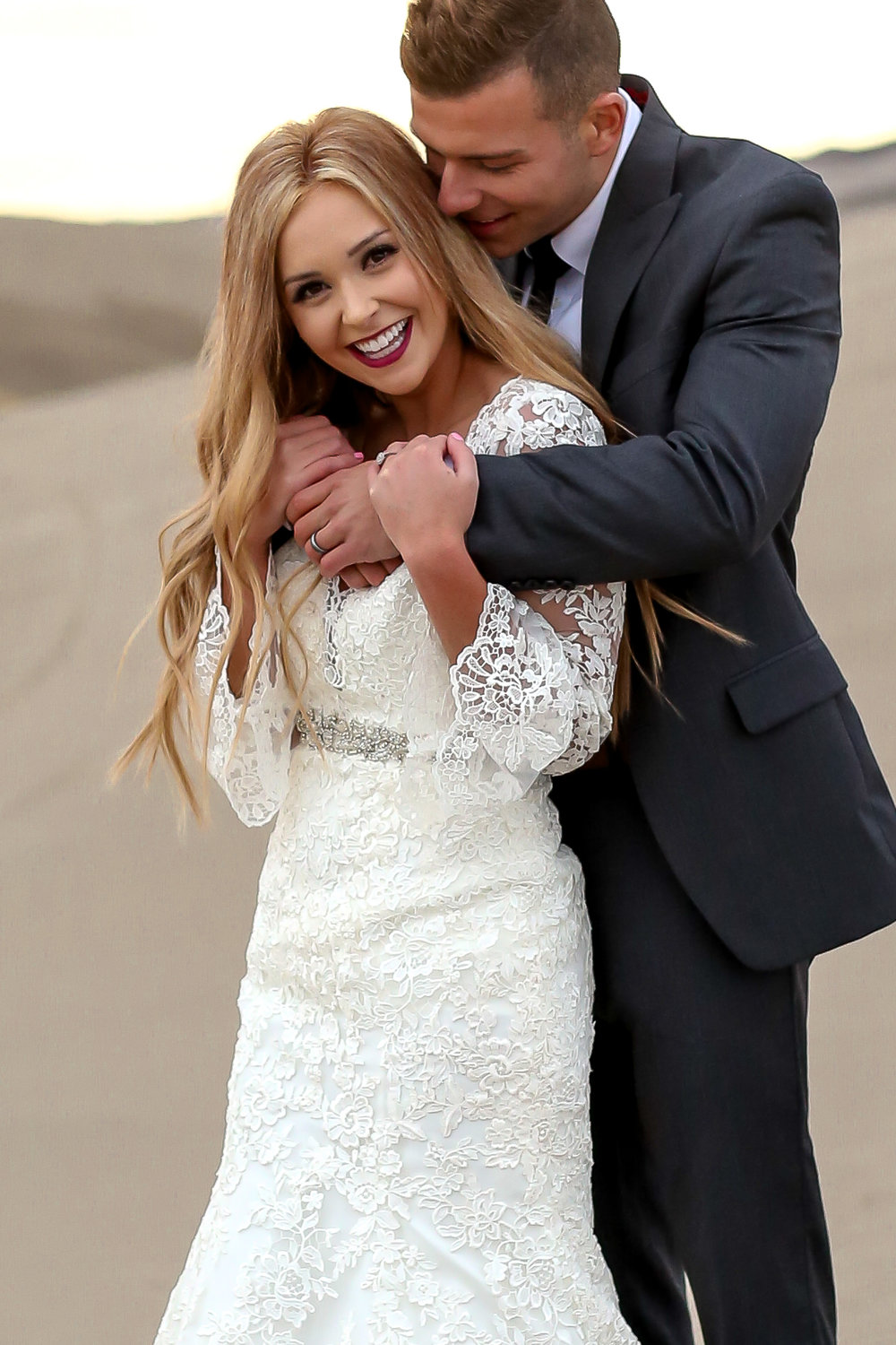 Candid bridal photos taken in Idaho at the sand dunes