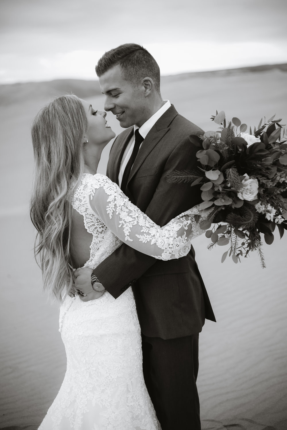 So in love couple taking bridals at the sand dunes in Idaho
