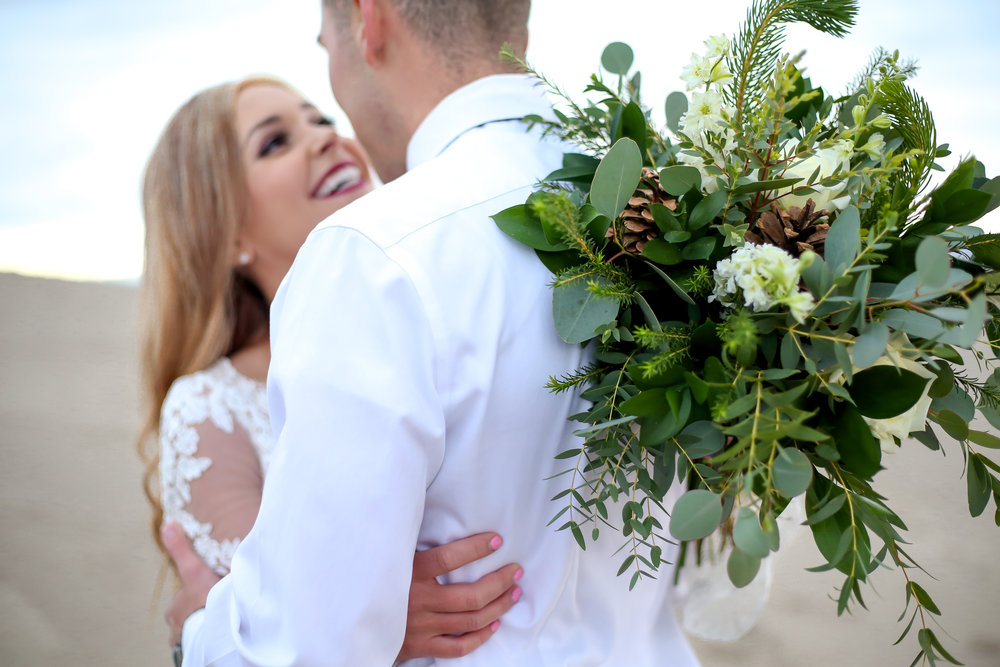 Gorgeous winter wedding bouquet full of greens and pine!