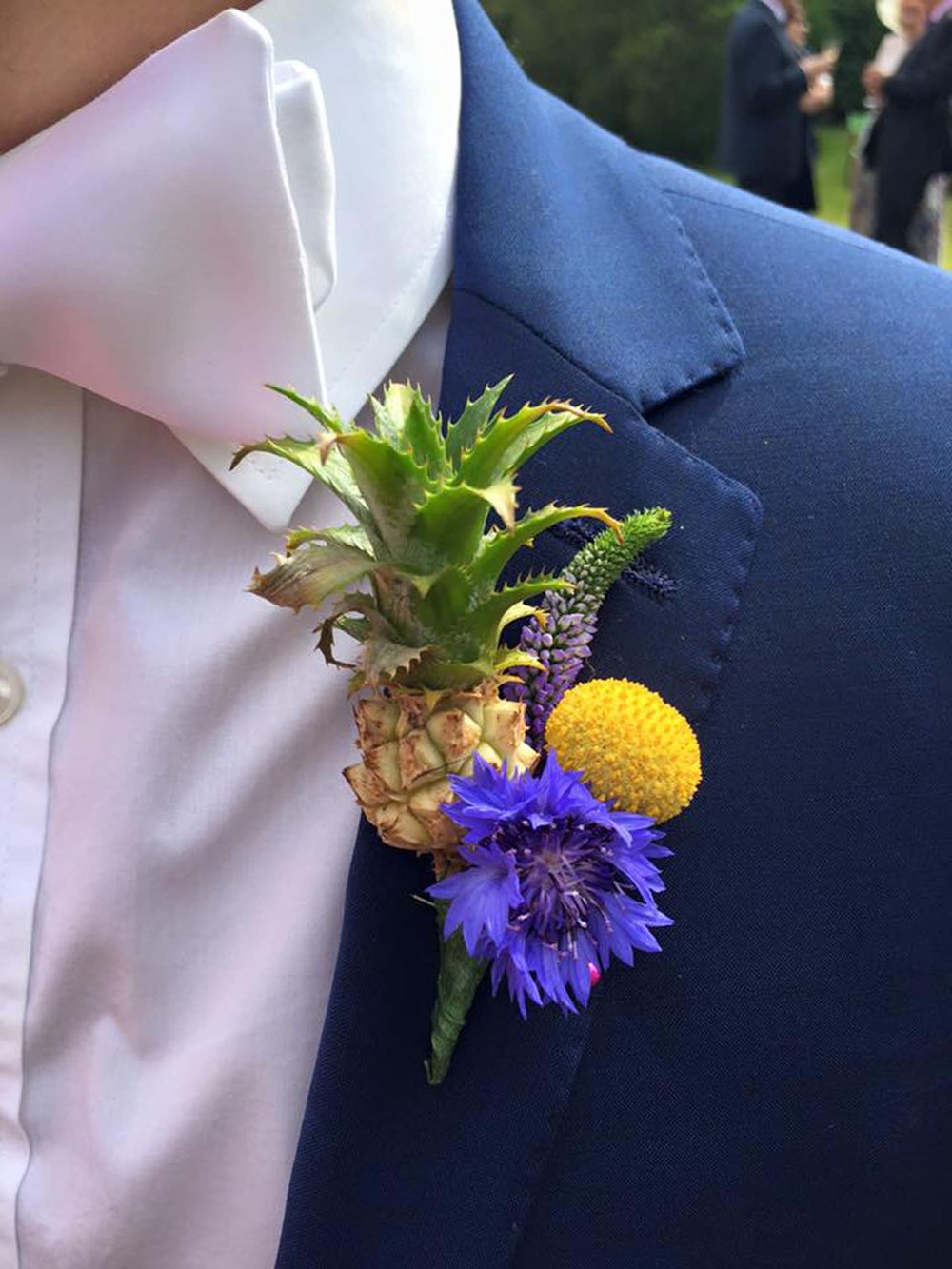 French-and-Fahey-Festival-Weddings-France-groom-pineapple-buttonholes.jpg